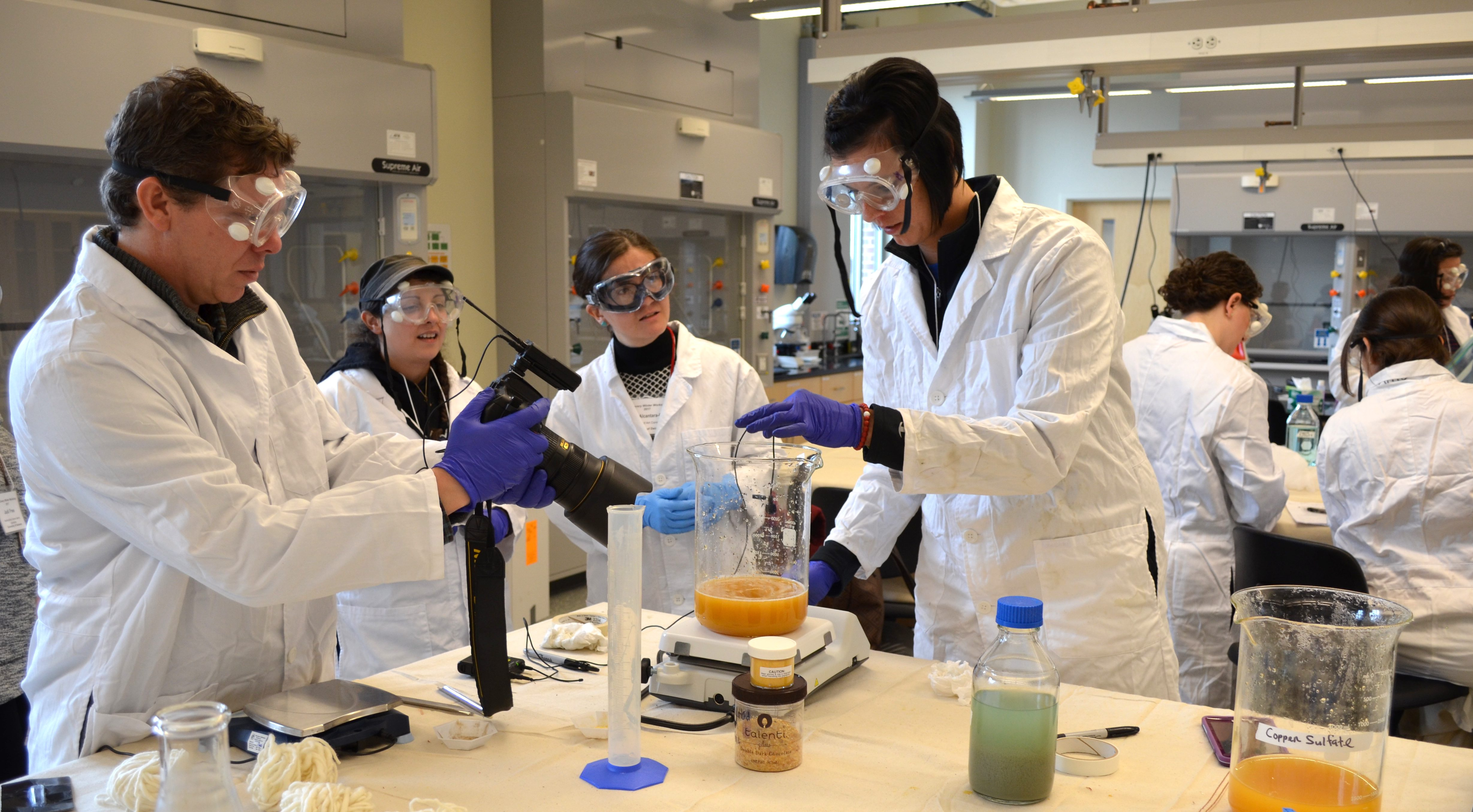 Students working with hot plates in a chemistry lab