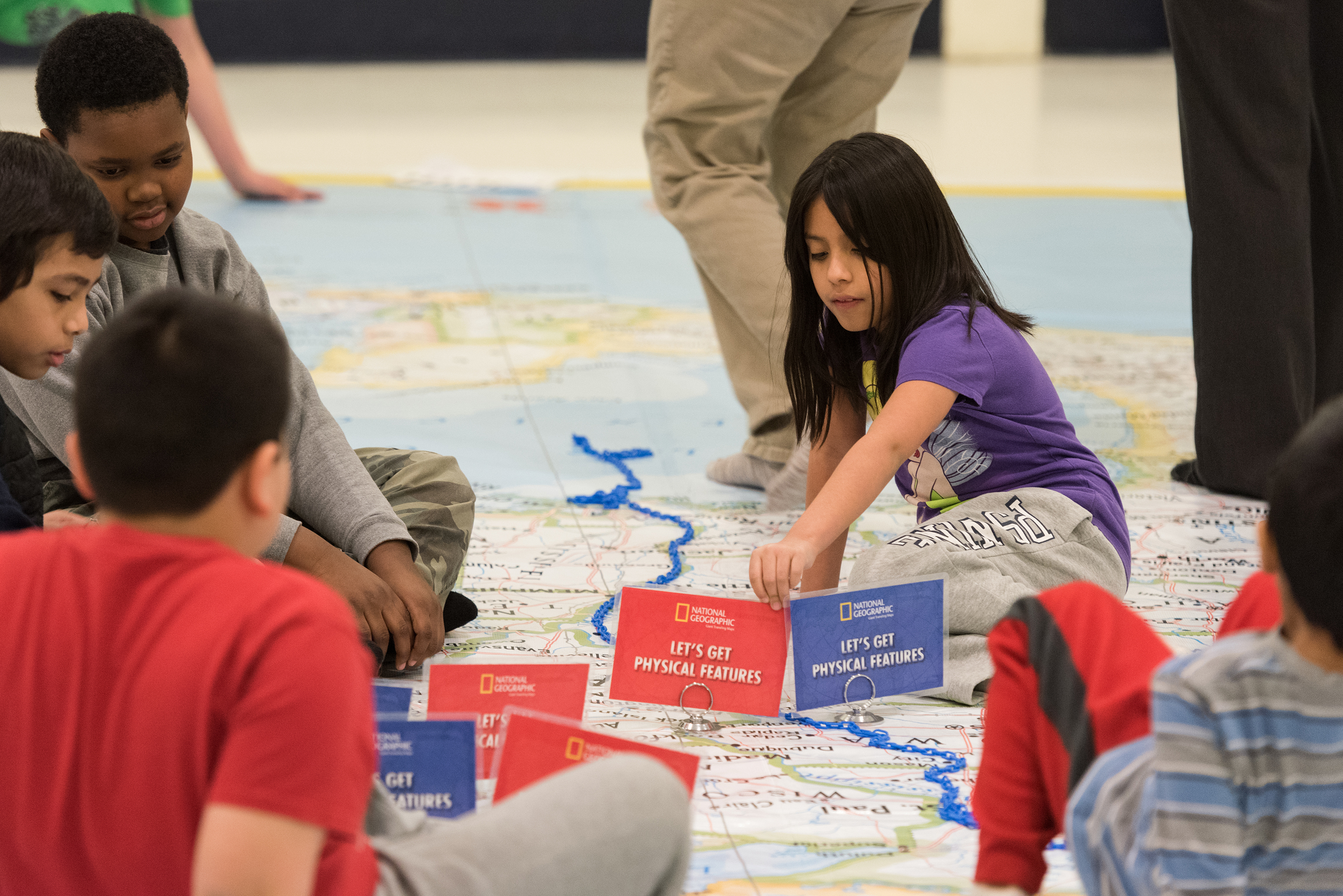 Students doing an interactive map activity