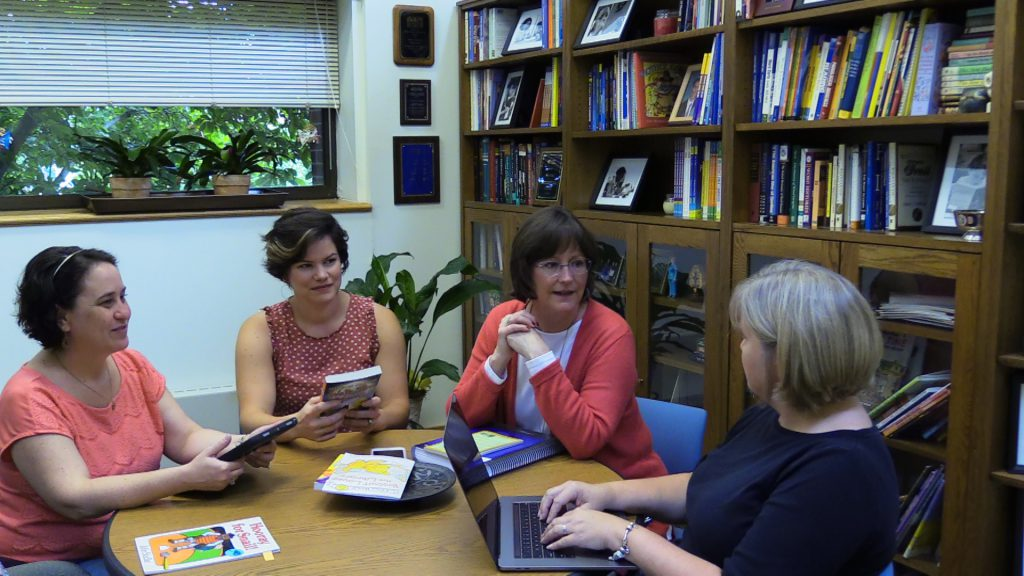 Walpole and literacy team discuss Bookworms.